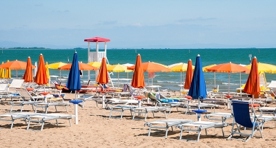 Relax on the white sand beach at Lignano