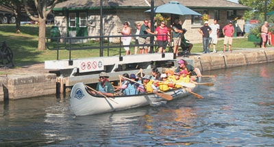 Canadian canoe going through a lock