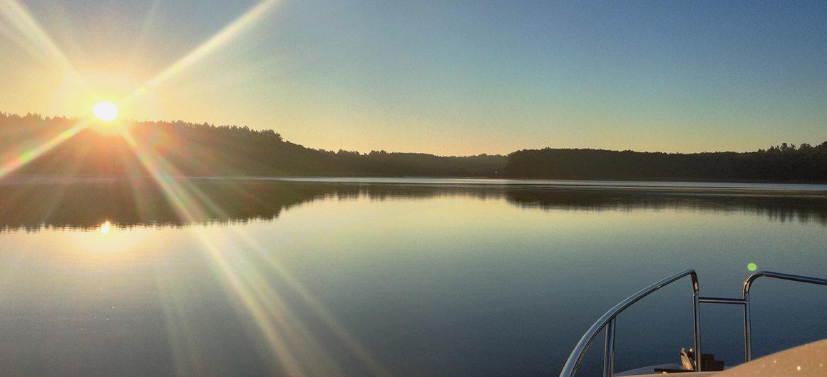 Royal Mystique boat at sunset, Lake Müritz, Germany